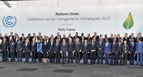 المشاركون في كوب 21 يقرون اتفاقا حول الاحتباس الحراري
